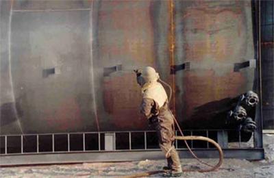 sandblasting a steel tank